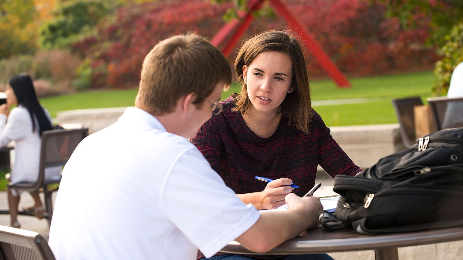 Graduate students study outside the Adel Coryell Learning Center on City Campus